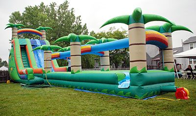 Luau themed giant water slide rentals